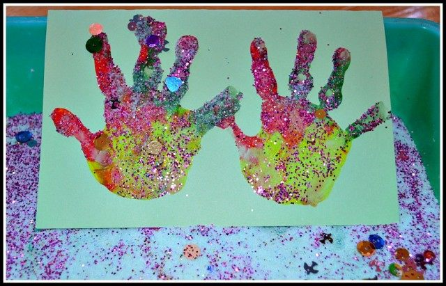 rainbow hand prints with salt glitter as christmas cards