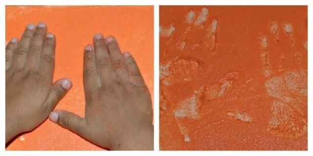 preschool writing with sensory paste and handprints