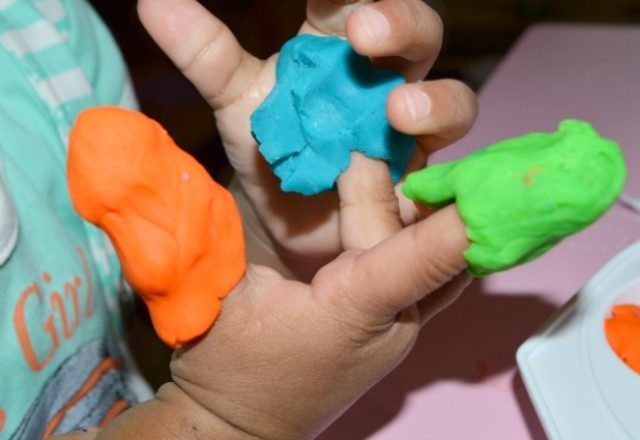 putting on play dough fingers