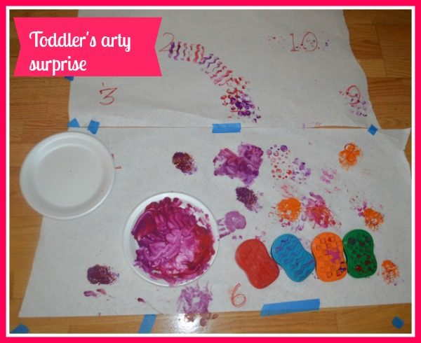 toddler painting hearts