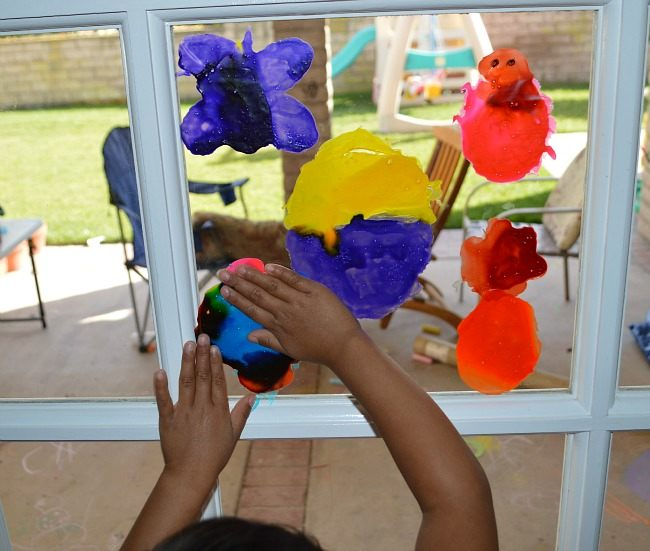 gluing on window clings homemade