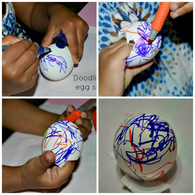 toddler writing on egg shells as fine motor activity