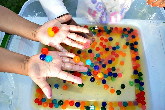 playing in water with boba pearls