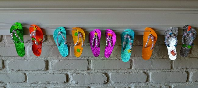 summer themed kids keepsakes hanging by fireplace