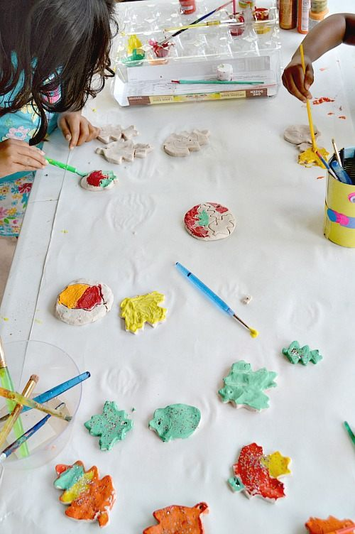 kids painting fall leaves