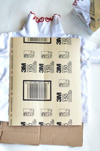 add cardboard to prevent crease