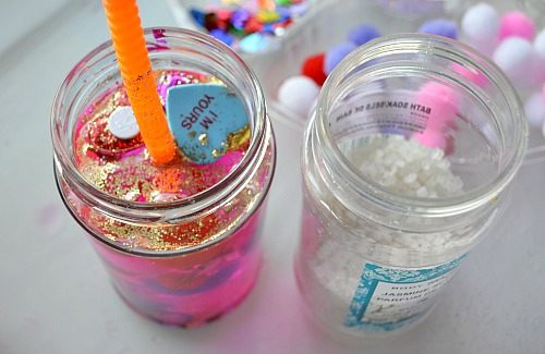 adding bath salts while creating Valentine's day sensory jars
