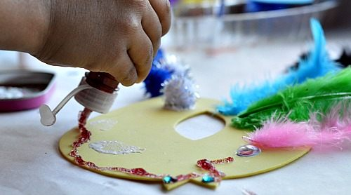 applying glitter glue spring craft for kids