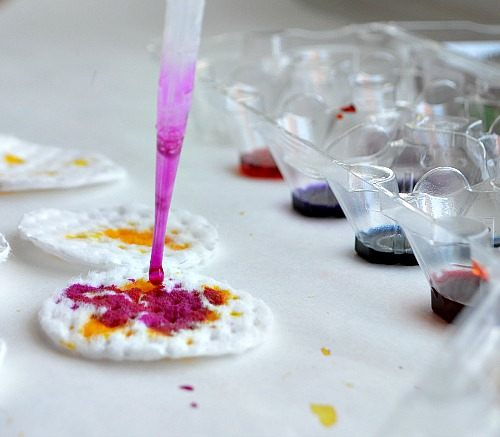 dropping watercolors on cotton rounds