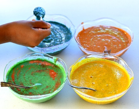 mixing homemade paints for kids