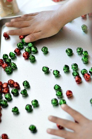 play with jingle bells fine motor play