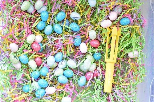 set up fine motor egg hunt sensory bin
