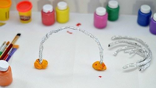 use playdough to keep the foil rainbow up