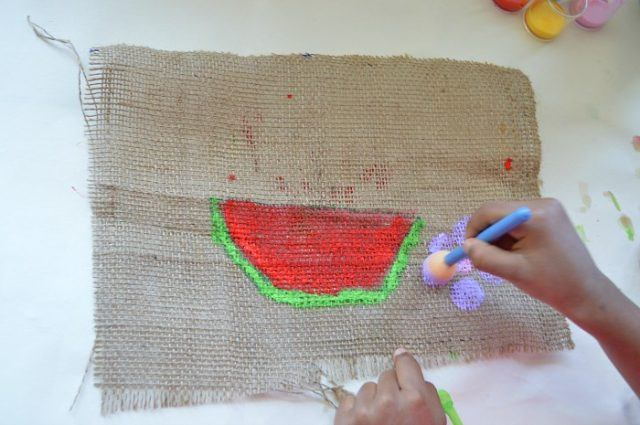process of creating art on burlap