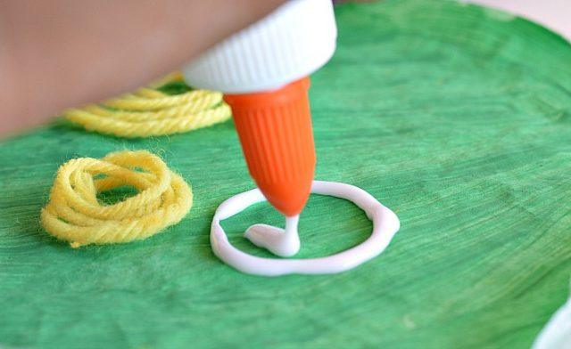 gluing yarn apples for apple crafts